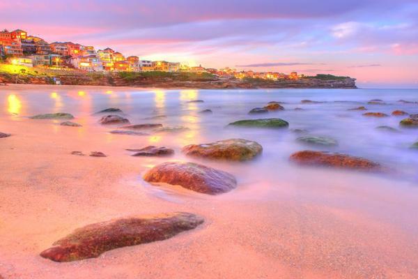 beach water stones sunset at sydney australia